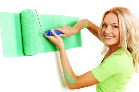 woman paints the wall brush Stock Photo - 8587141