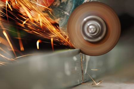 power saw: metal sawing close up sparks spray