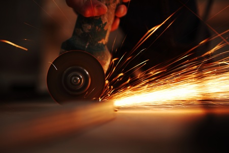 metal sawing close up sparks spray photo