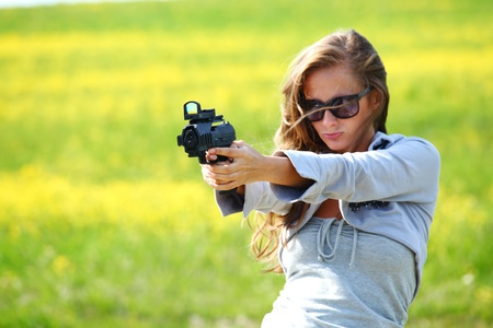 woman with pistol close up portrait photo