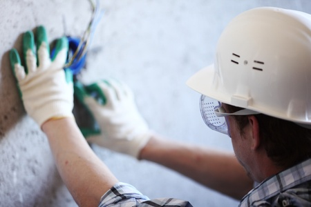worker puts the wires in the wall Stock Photo - 8587172