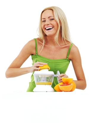 woman squeezes juice by juicer Stock Photo - 8585481