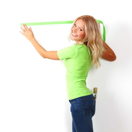 women often with a measuring tape to the wall Stock Photo - 8585023