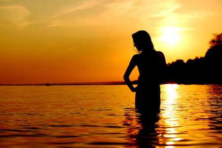beach model: ocean woman in sunrise light