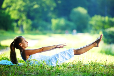 yoga meditation:  woman lay and training on ground  Stock Photo