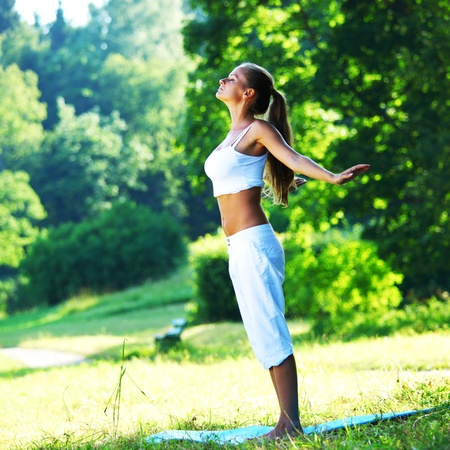 yoga woman on green park background photo