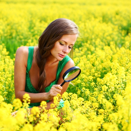 botanist woman in yellow flower field Stock Photo - 8586583