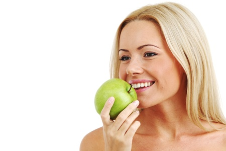 blond woman eat green apple on white Stock Photo - 8675246
