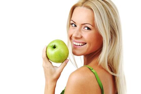 blond woman eat green apple on white Stock Photo - 8675739
