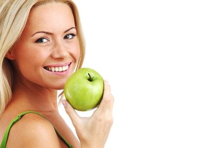 blond woman eat green apple on white Stock Photo - 8674892