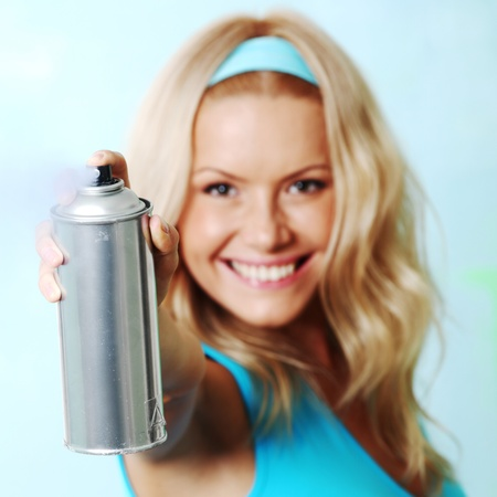 aerosol can:  woman paints the wall of balon Stock Photo