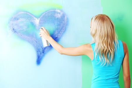 woman paints the wall of balon photo
