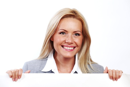 business woman hidden behind a white sheet of paper Stock Photo - 8674766