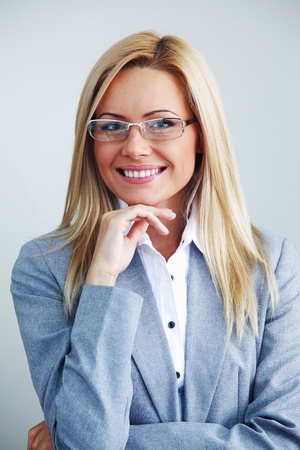 business woman in glasses on gray background Stock Photo - 8677768