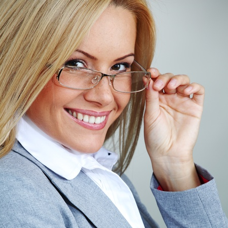 business woman in glasses on gray background Stock Photo - 8675821