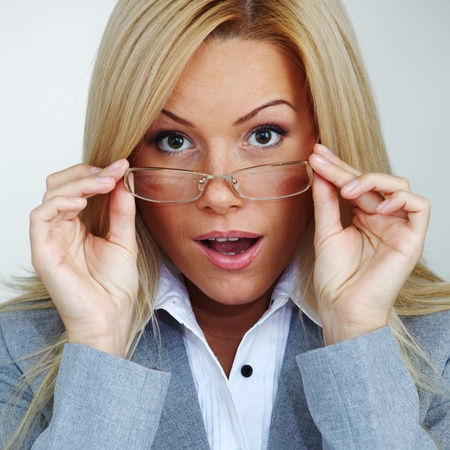business woman in glasses on gray background Stock Photo - 8675823
