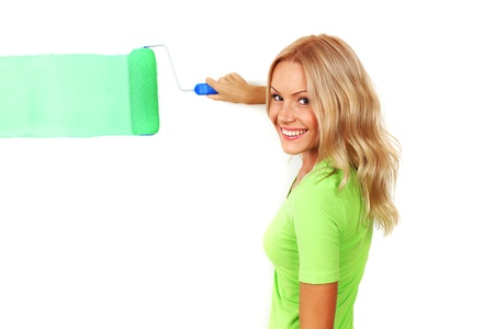 woman paints the wall brush Stock Photo - 8674663