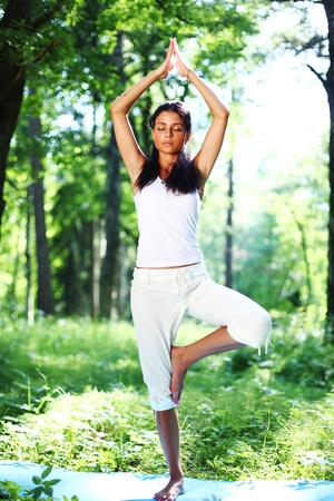 yoga woman on green grass in forest Stock Photo - 8675929