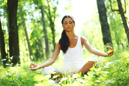 yoga woman on green grass in forest Stock Photo - 8675862