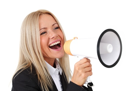 loud: businesswoman with megaphone studio isolated
