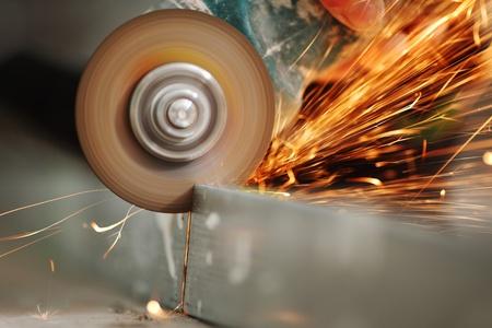 sawing: metal sawing close up sparks spray