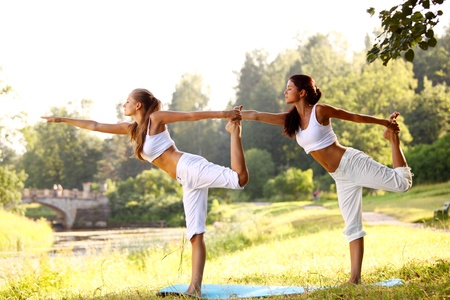 yoga woman on green park background Stock Photo - 8675863