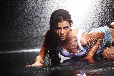 sexy woman in water studio photo