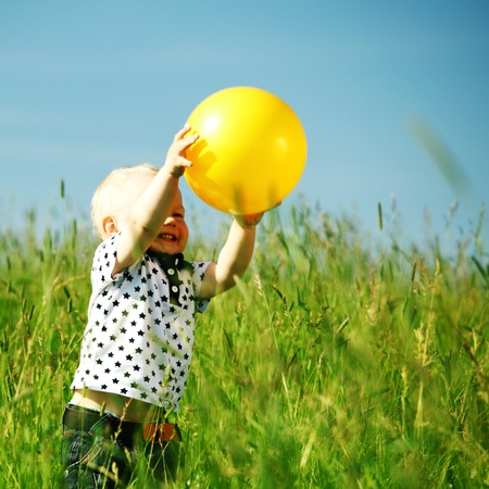 young smile boy play yellow ball Stock Photo - 8679905