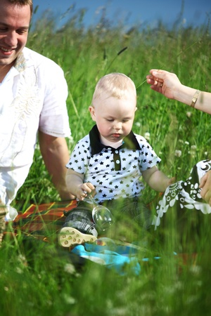 picnic of happy family on green grass Stock Photo - 8679941