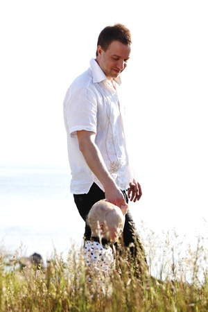 father and son walking around photo