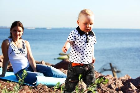 ifestyle: picnic of happy family near sea