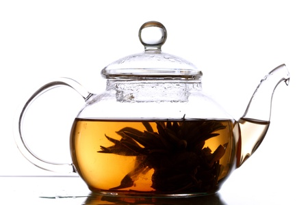 tea in glass pot isolated photo