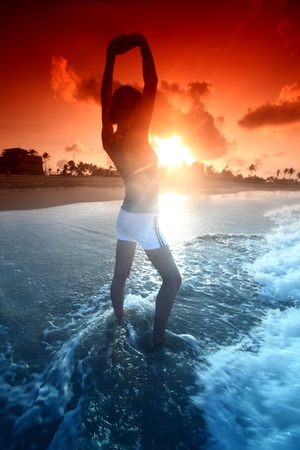 girl stay in ocean and say hello sun Stock Photo - 8740103