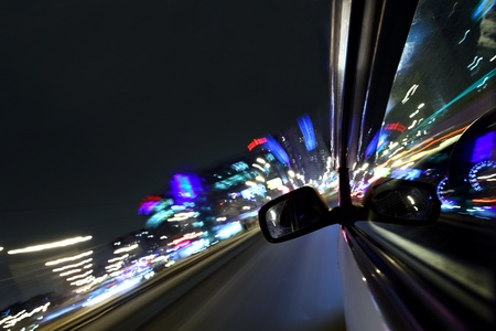 car fast drive on highway in night Stock Photo - 8739712