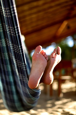 young girl feet: girl on vacation relax in hammock Stock Photo