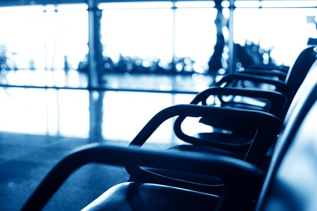 departures board: airport seats wait airplane arrival Stock Photo