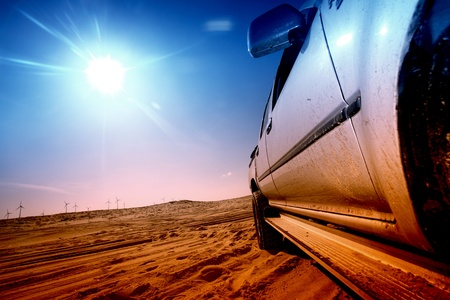 truck in desert sand and blue sky photo