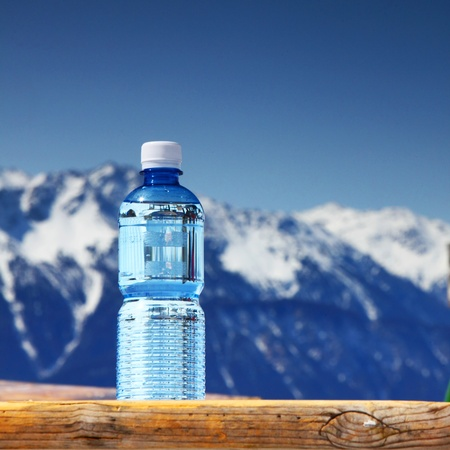 mineral water: water in cup mountains on background Stock Photo