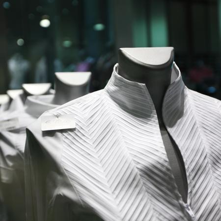 showcase with white clothes photo