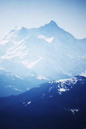 top of mountains in blue sky Stock Photo - 8740066