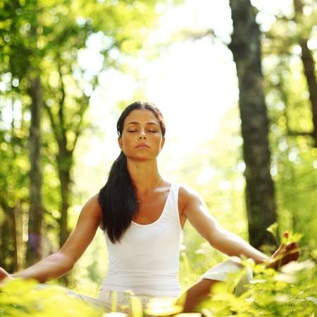 meditation lotus: yoga woman on green grass in forest