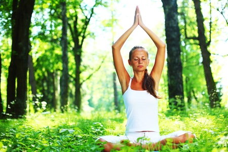 yoga woman on green grass in forest Stock Photo - 8743889