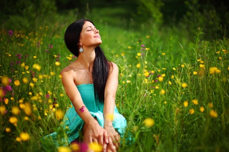 energy fields: beautiful woman on flower field