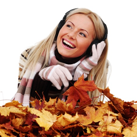 autumn woman listening music in studio photo