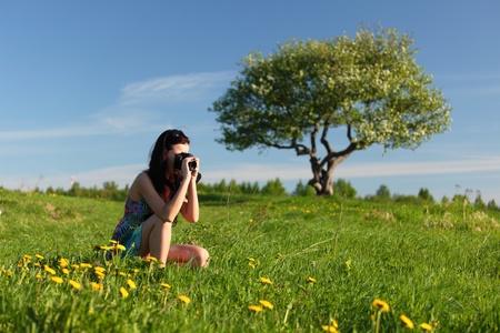 woman photographer on green grass field Stock Photo - 8743918