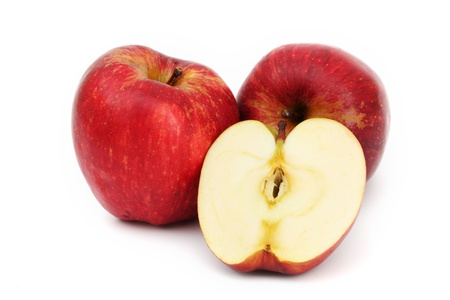 red apples pile slice isolated on white photo