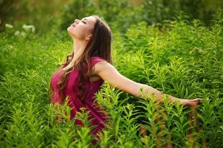 woman on green grass field close portrait Stock Photo - 8743925