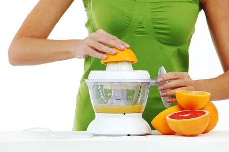 woman squeezes juice by juicer Stock Photo - 8743702