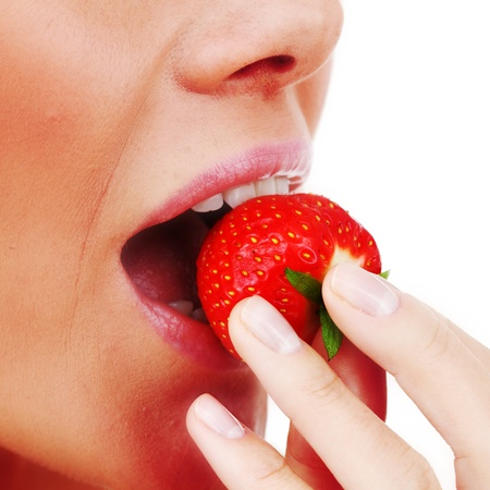 woman eat strawberry macro close up photo