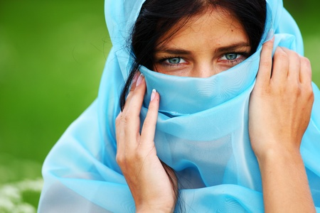 modesty: woman portrait in blue fabric